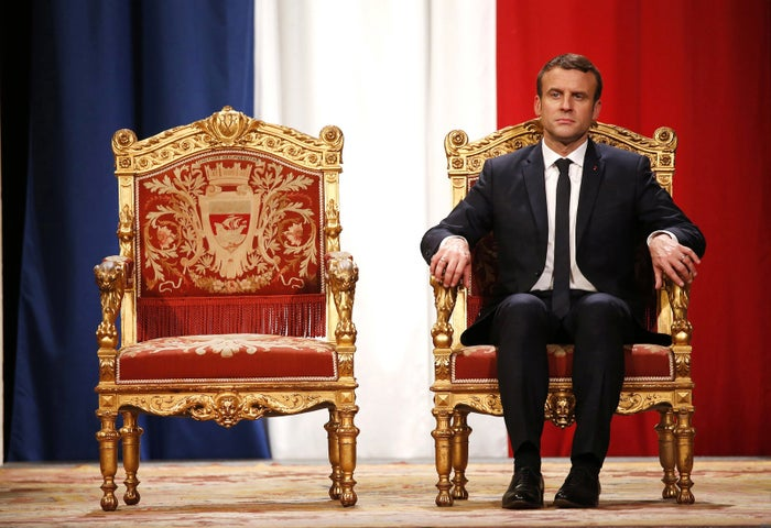 French President Emmanuel Macron listens to Paris Mayor Anne Hidalgo deliver a speech at a ceremony at the Hotel de Ville in Paris on May 14.