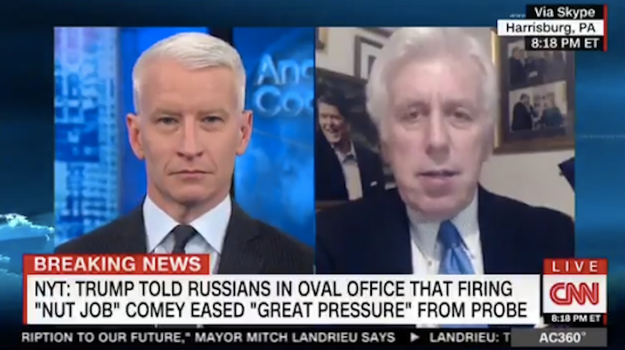 "This week's intense news cycle might have been a bit much for CNN's Anderson Cooper, who told a Trump surrogate Friday that he'd probably defend the president even if he ""took a dump on his desk."""