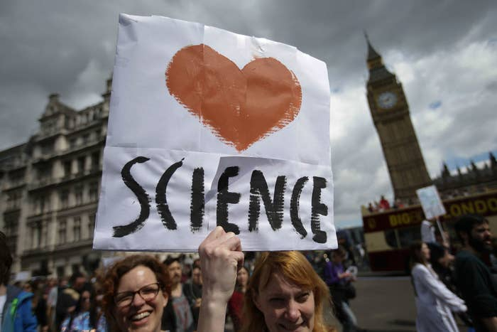 A protester holds a placard as scientists and science enthusiasts participate in the March for Science in London.