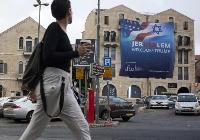 """A sign says """"Jerusalem welcomes Trump"""" in Jerusalem."""