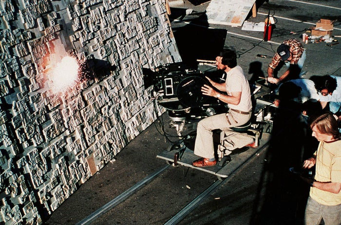 The Star Wars production crew films live explosions on a surface of a model Death Star.