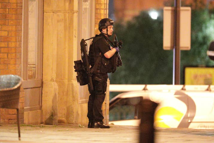 Police near the Manchester Arena after reports of an explosion.