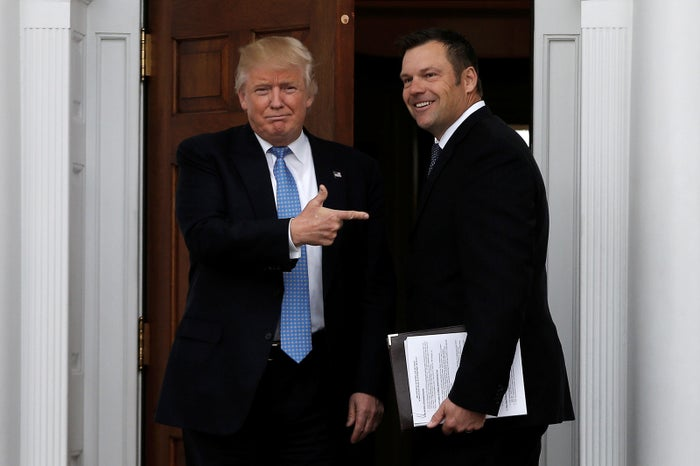 Donald Trump stands with Kansas Secretary of State Kris Kobach before their meeting at Trump National Golf Club in Bedminster, New Jersey.