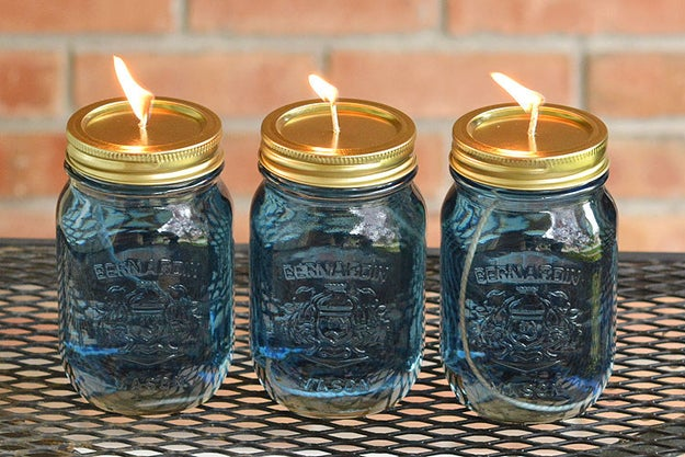 Keep the mosquitoes away all summer with Mason jar citronella candles.