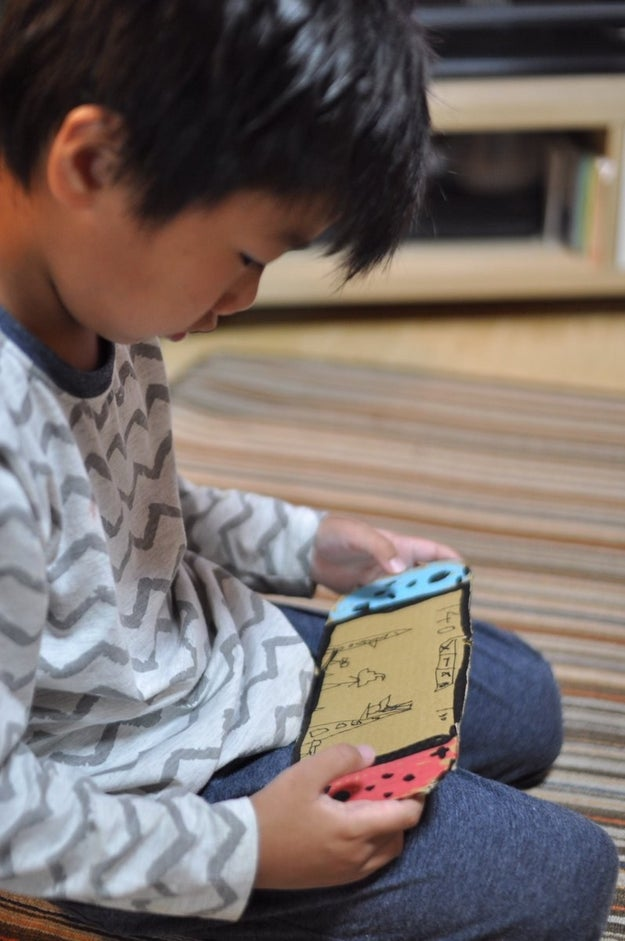 This is Kazutoyo, a 6-year-old boy from Japan. Kazutoyo desperately wanted a Nintendo Switch, so he decided to make his own out of cardboard.