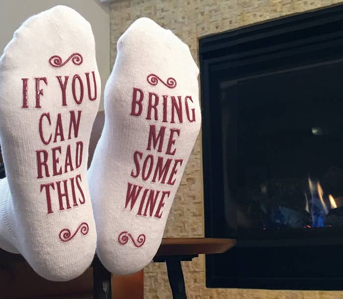 """Get them from Amazon for $12.95.Promising review: """"These socks are thick and cozy anklet socks. The writing on the bottom of them is anti-slip as well, which really helps...especially if someone actually does bring you the wine, lol. Perfect gift for yourself or someone else!"""" —Ashley Bates"""