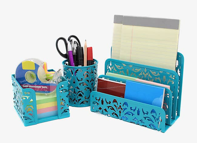 """Promising Review: """"This set is darling and very handy. I even ordered extra pencil cups to store rubber bands, scissors, markers, and other items!"""" —Layla Get it from Amazon for $14.99."""