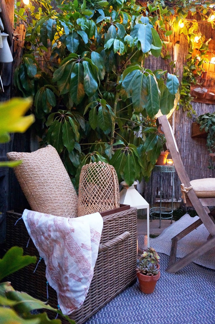 You can purchase a really pretty rattan storage ottoman from Urban Outfitters for $149 or you can make your own with an old terra cotta pot and a coat of paint. See the tutorial on BuzzFeed Nifty Outdoors.See more of this gorgeous backyard on Tiny Canal Cottage.