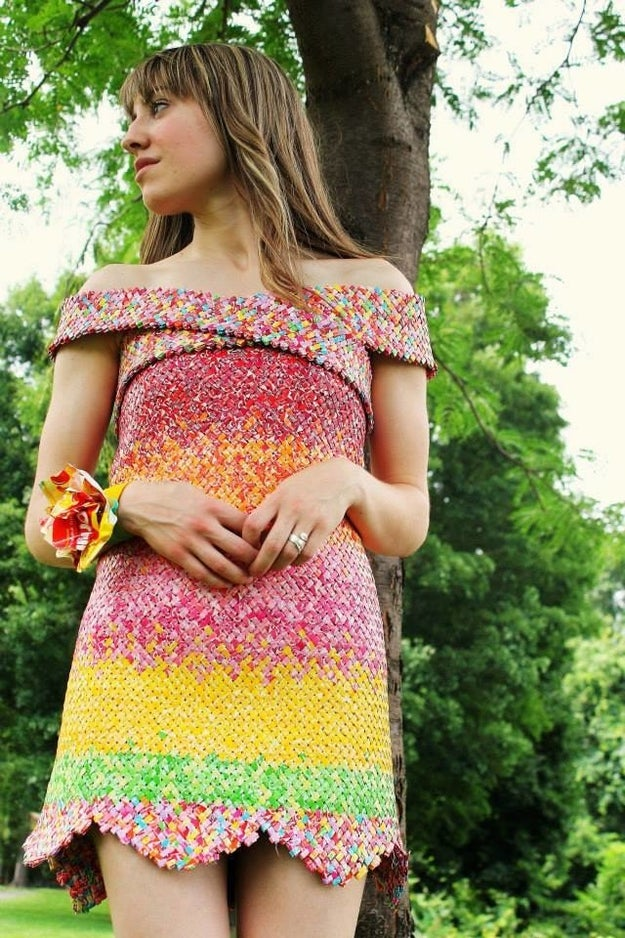 This is Emily Seilhamer, a Pennsylvania-based artist and upcycling enthusiast. And that freakin' adorable dress she's wearing is made out of freakin' Starburst wrappers.