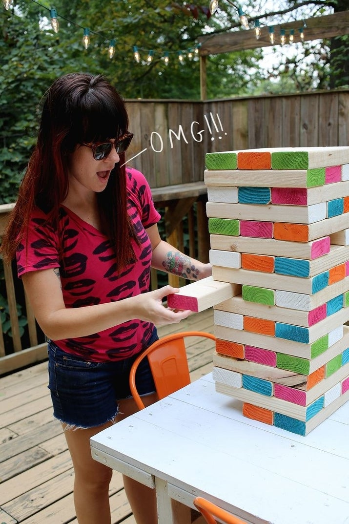 See how to make this giant Jenga on A Beautiful Mess. Check out 27 Insanely Fun Outdoor Games You'll Want To Play All Summer Long if you are looking for a few more ideas.