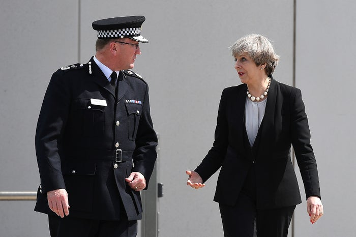 Britain's Prime Minister Theresa May talks with Chief Constable of Greater Manchester Police Ian Hopkins.