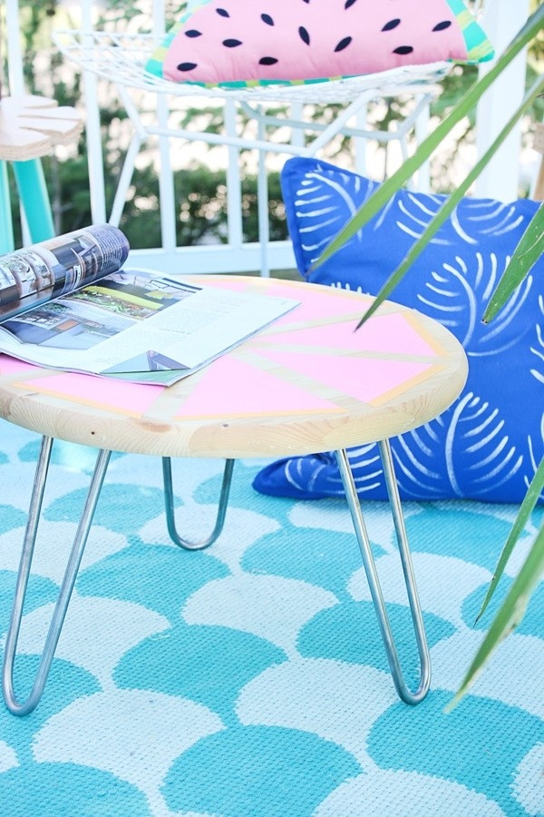 Attach some hairpin legs to a painted pine round for a useful side table.
