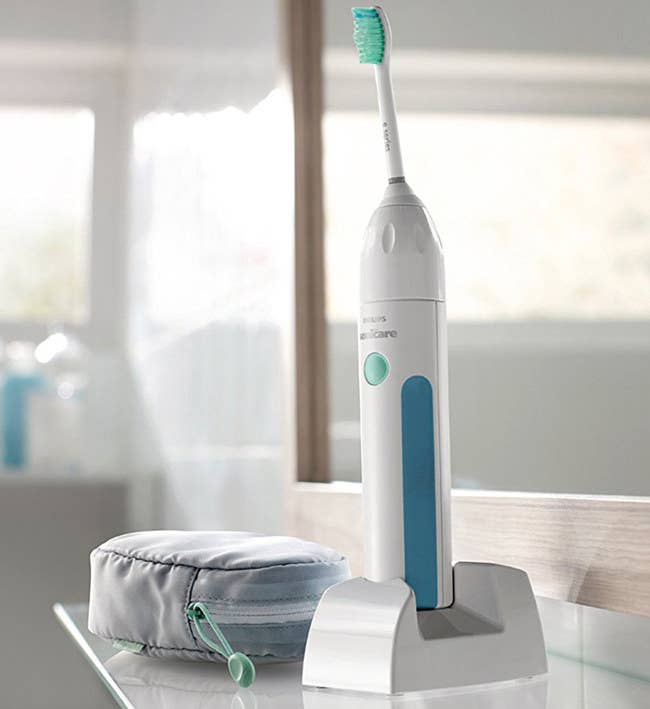"Promising Review: ""As a general dentist with more than 30 years of experience, I see the positive effects that Sonicare toothbrushes have on my patients' oral health. Less adhered bacteria translates to less gum disease, tooth decay, and tartar buildup. My previous Sonicare used the diamond clean brush heads and failed after four years. This brush employs a more-hygienic brush handle base, which does not accumulate toothpaste scum as my previous model did."" —Tipiw Get it from Amazon for $24.97. Available in two colors."
