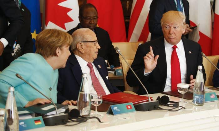 Trump with German Chancellor Angela Merkel and Tunisian President Beji Caid Essebsi on Saturday.