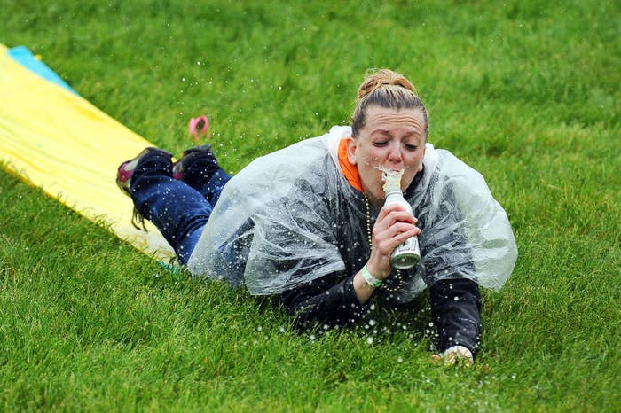 A fan slides down a Slip 'N Slide in the infield prior to the 139th running of the Kentucky Derby on May 4, 2013.