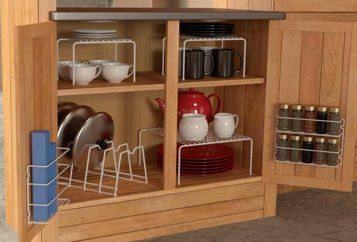 """Promising review: """"I love how organized my shelf is now! It fits in perfectly and is very sturdy. I put pans, lids, plates, spices, saran wraps, and coffee items in it."""" --BarbaraGet it from Amazon for $14.68 (down from $23.99)."""
