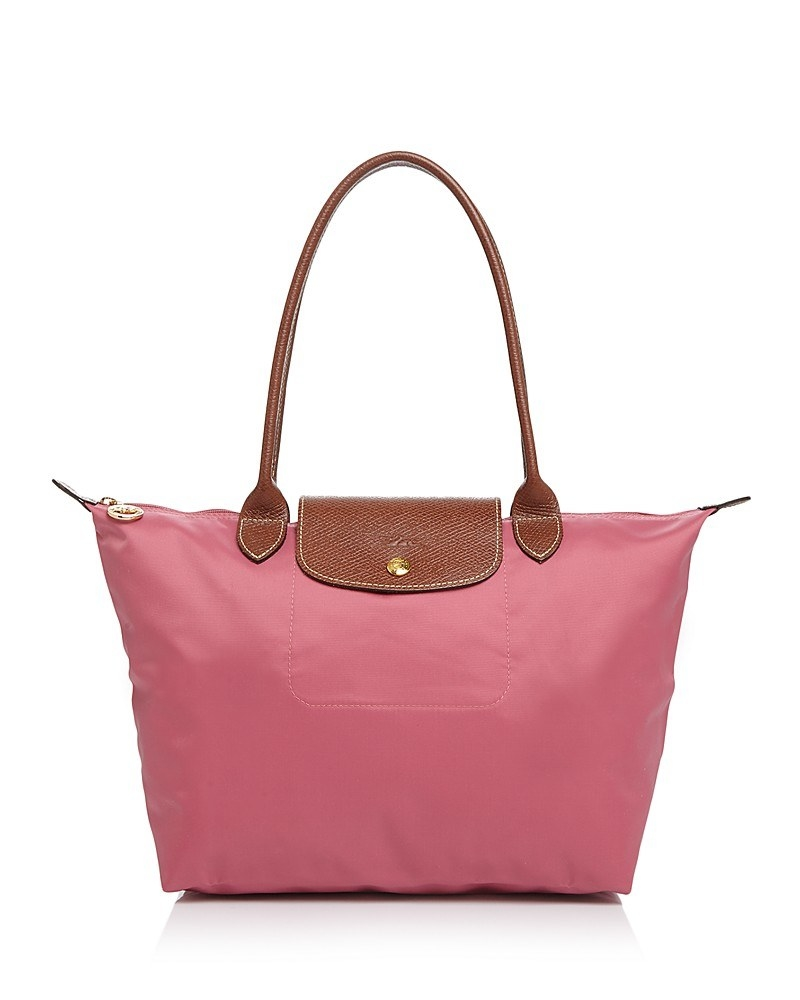 This Longchamp shoulder tote that folds up for easy storage and transport. 0fab60398427d