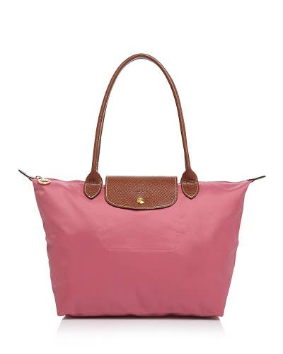 c848a4887 This Longchamp shoulder tote that folds up for easy storage and transport.