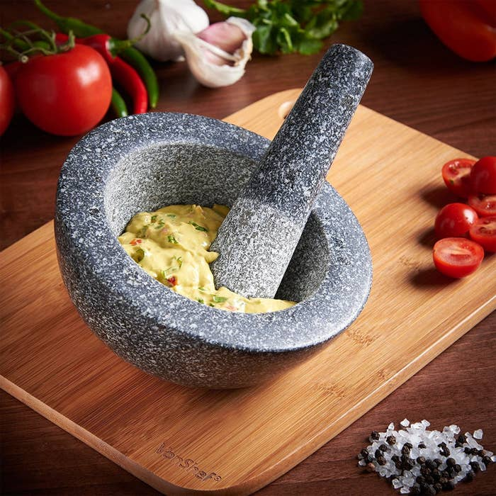 """Promising Review: """"Pulling it out of the box, I was impressed with the weight. The outside of the mortar and the grip part of the pestle are smooth and polished. The bowl of the mortar and the business end of the pestle are textured. It does a fine job of mashing an avocado or working through spices. The angled mortar also works well with the spices, when the heavier, unground spices naturally fall to the bottom as you grind."""" —Prairie ParsonGet it from Amazon for $19."""
