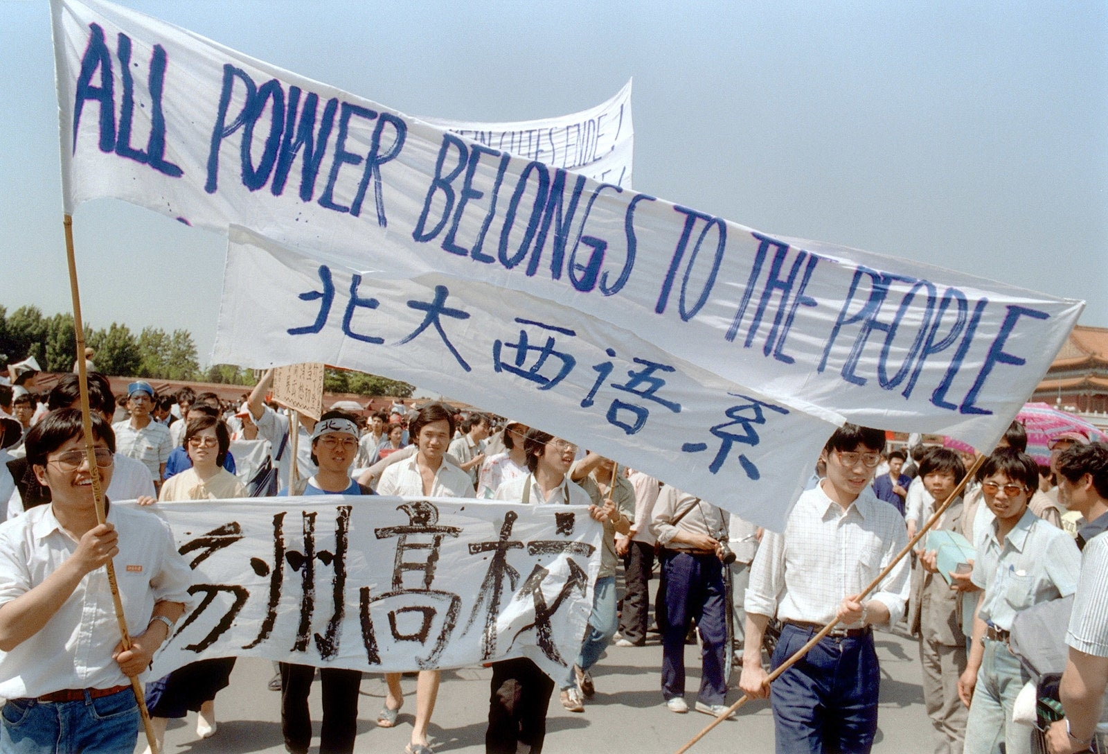 Waving banners, high school students march in Beijing streets near Tiananmen Square on May 25, 1989, during a rally to support the protest against the Chinese government.