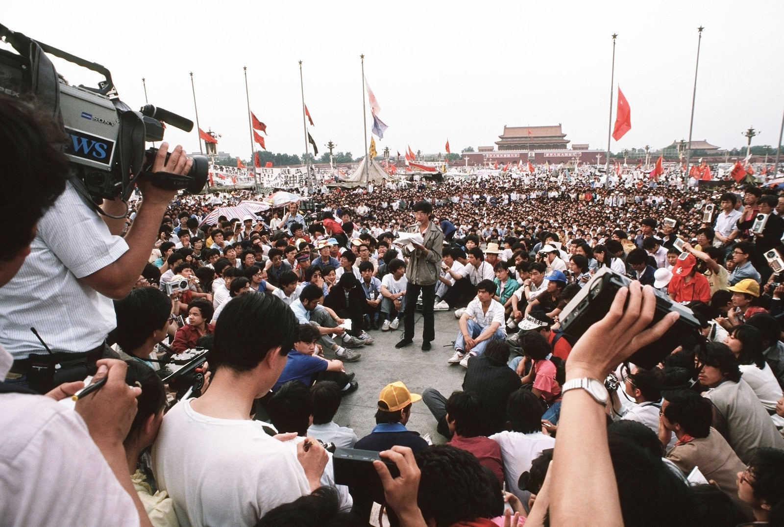 A pro-democracy movement leader talks into a microphone as he gives a press conference in Tiananmen Square.