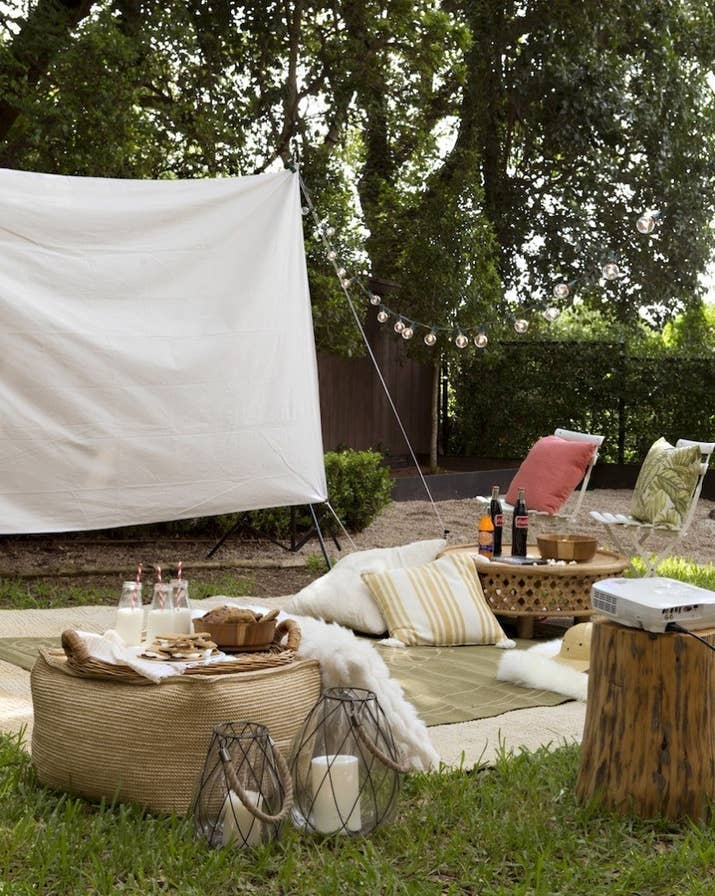 See how to make the movie screen out of canvas and tent poles on Camille Styles. You can get a pretty decent projector on Amazon for $40, but if you're movie night is more spontaneous, try making one out of a shoebox and your phone.
