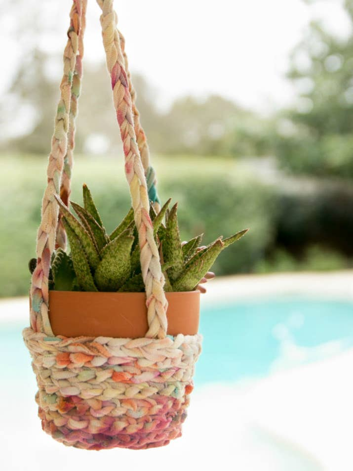 See how to crochet your old shirts together for a gorgeous hanging basket on Jennifer Perkins.