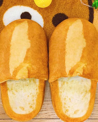3c3a3dc89790 Bread slippers you ll want to baGET immediately. They re guaranteed to keep  your feet warm and toasty.