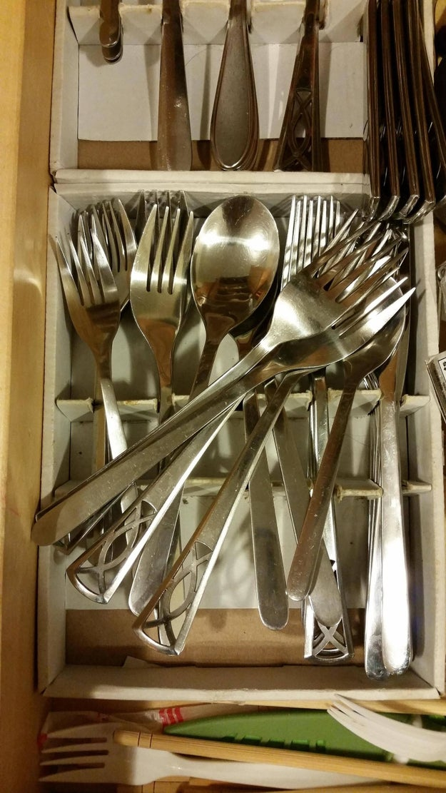 You thank your roommate for putting the silverware away and then go back and fix it later.