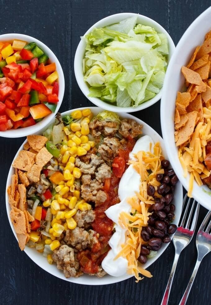 Grocery list-1 lb. ground turkey: $5.99-1 package taco seasoning: $0.99-1 head iceberg lettuce: $2.99-1 can black beans: $0.99-1 onion: 0.79-2 peppers: $1.79-1 can corn: $1.59-1 bag shredded cheddar: $2.99-Salt and pepper: Pantry staplesTotal cost: $18.12Get the recipe.