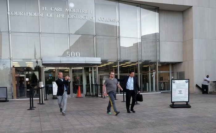 Bryan Moles, center, leaves DC Superior Court on Thursday.