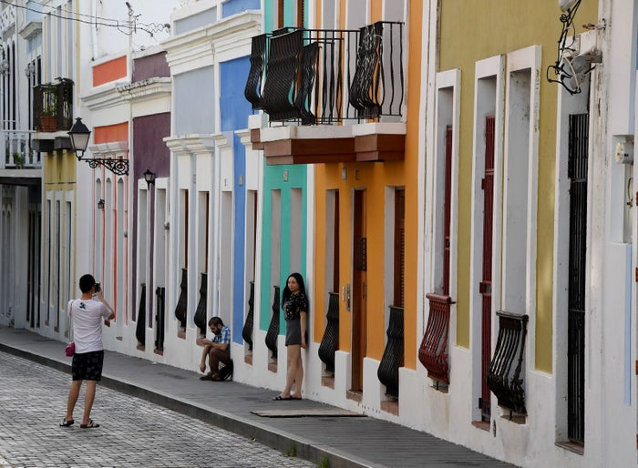 People walk through the streets of the old town in Puerto Rico's capital, San Juan.