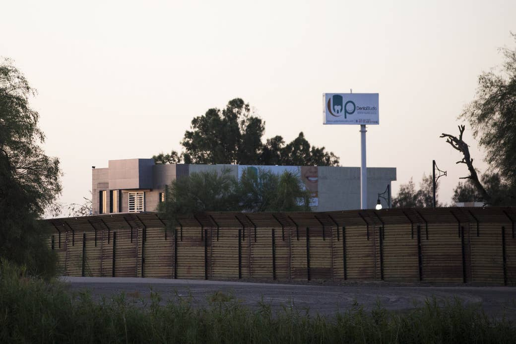 A Mexican dental office is visible from the California side of the border on May 18, 2017, in Los Algodones, Mexico.