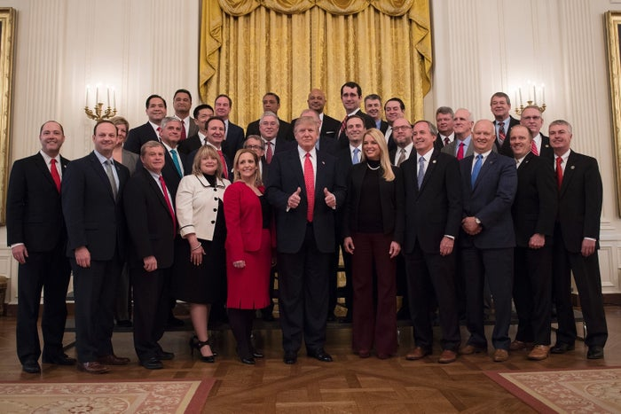 President Donald Trump gives two thumbs up as he poses with the National Association of Attorneys General at the White House in Washington, DC, February 28, 2017.