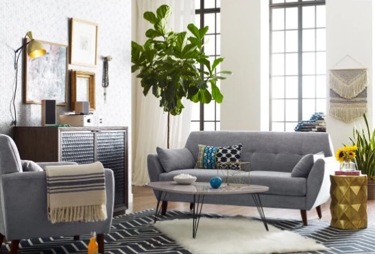 a midcentury loveseat with angled tapered legs