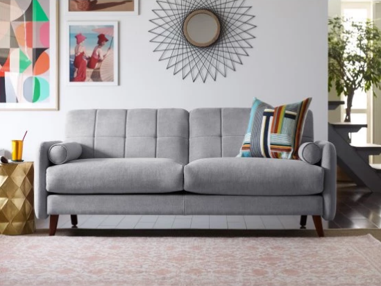 A Mid Century Modern Sofa Made With Stain Resistant Microfiber.