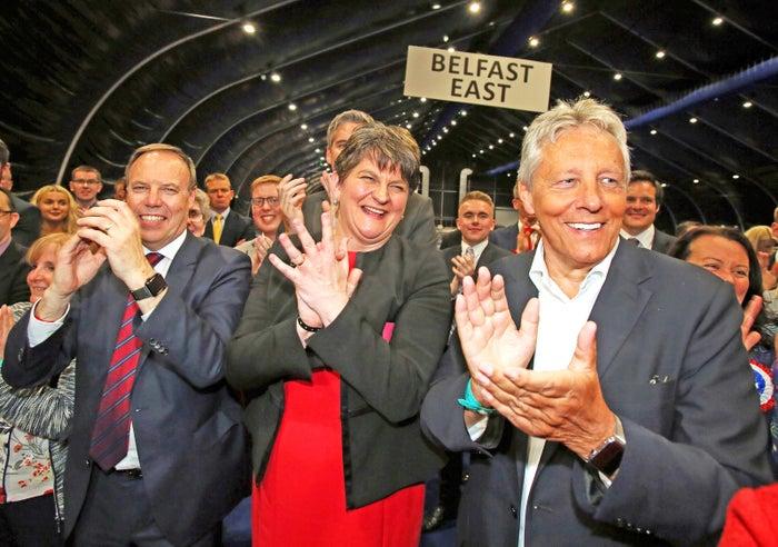 Democratic Unionist Party (DUP) deputy Nigel Dodds (l), leader Arlene Foster (c) and Former Democratic Unionist Party (DUP) Leader, Peter Robinson (r).