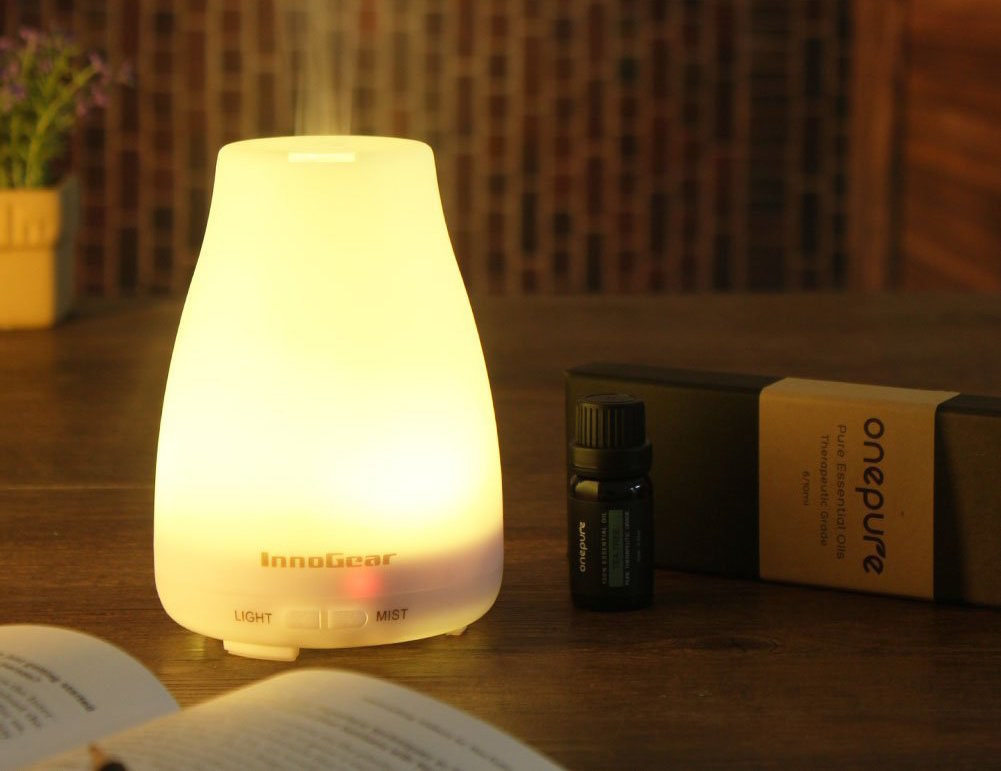 The essential oil diffuser in white, lit up