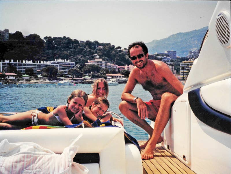 Young on holiday with his then wife Michelle and daughters Sasha and Scarlet.