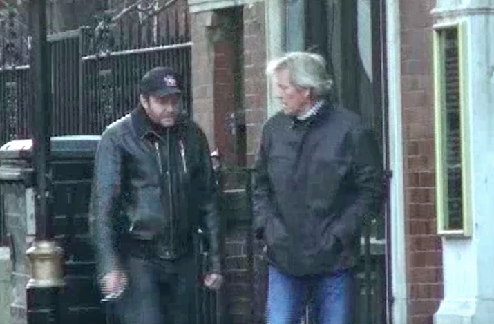 Young (left) was caught on film meeting the crime boss Patrick Adams in London.