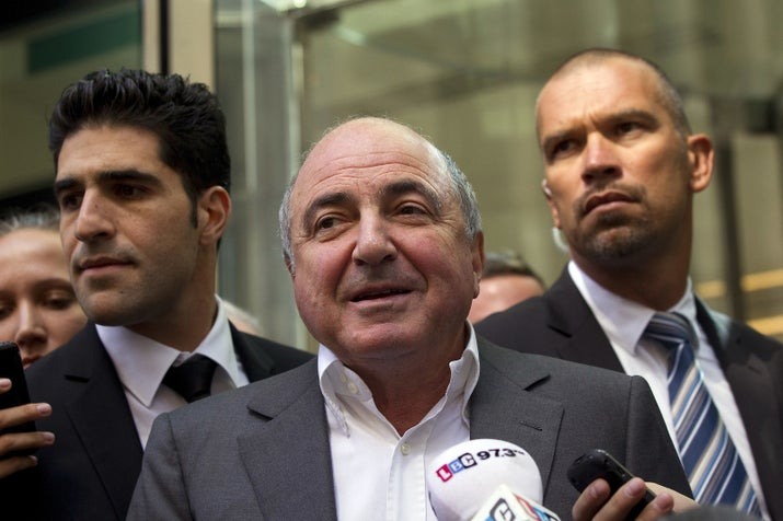 Boris Berezovsky after losing the High Court dispute with Roman Abramovich that ruined him financially. His bodyguard, Avi Navama, is to his left.