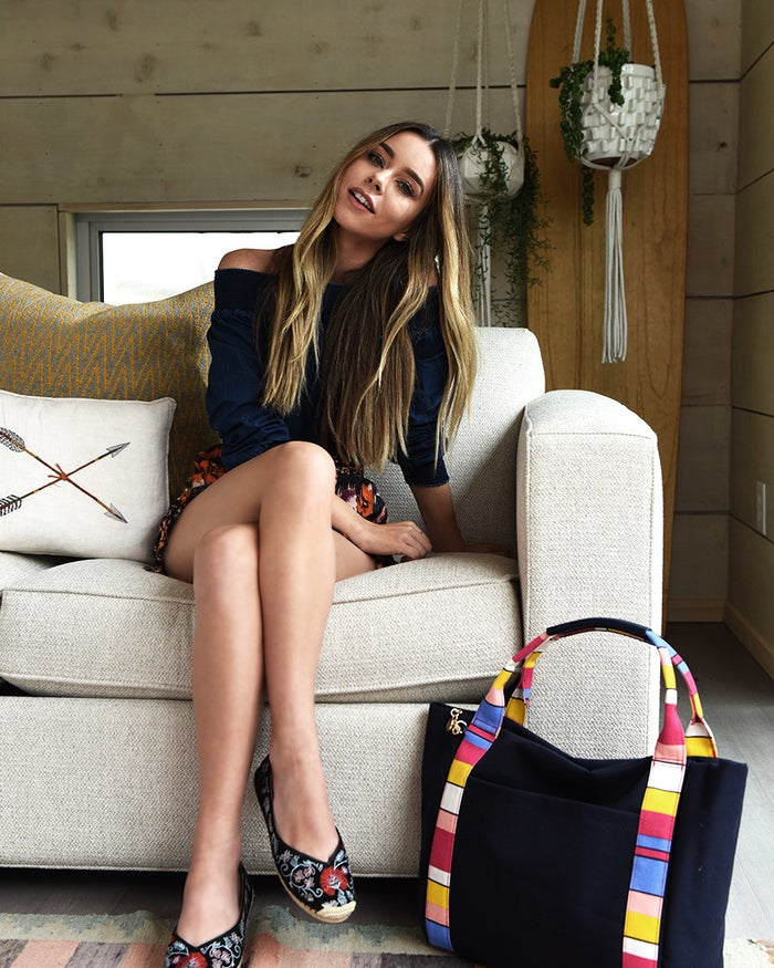 Sierra Furtado is wearing Free People shorts, and Avec Les Filles flats, paired with a Tommy Hilfiger tote.Personal styling tip: The cold-shoulder trend looks awesome on everyone, so pair it with a flouncy skirt or flowy summer shorts to add movement to your lower half. This will contrast great with the sleekness of your bare shoulders. Add a secondary trend: Flats are huge this summer — there are mules, slides and espadrilles — and, thank goodness, because comfort is key on those super-hot days. Bonus: They pair great with cold-shoulder tops because they add a low-key vibe to a feminine piece!