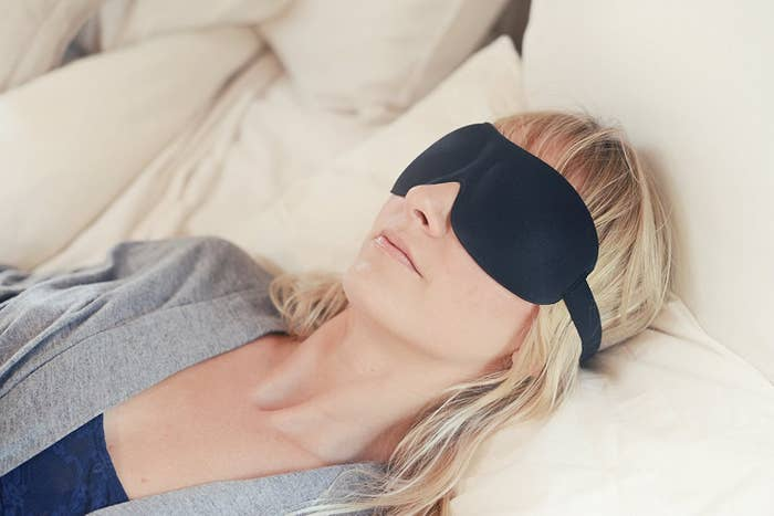 "Promising Review: ""I needed something to block out light during my naps. These are great! I love that there is room for you to open your eyes while wearing it and not have smashed eyelashes or eyelids. I also notice that my family members are behaving in a much quieter manner around me when I have it on because they know that I am serious about sleeping when wearing it. Yay, me!"" —Anna BananaGet it from Amazon for $12."