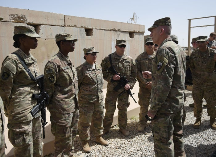 The US commander in Afghanistan John Nicholson talks with soldiers ahead of a handover ceremony at Leatherneck Camp.