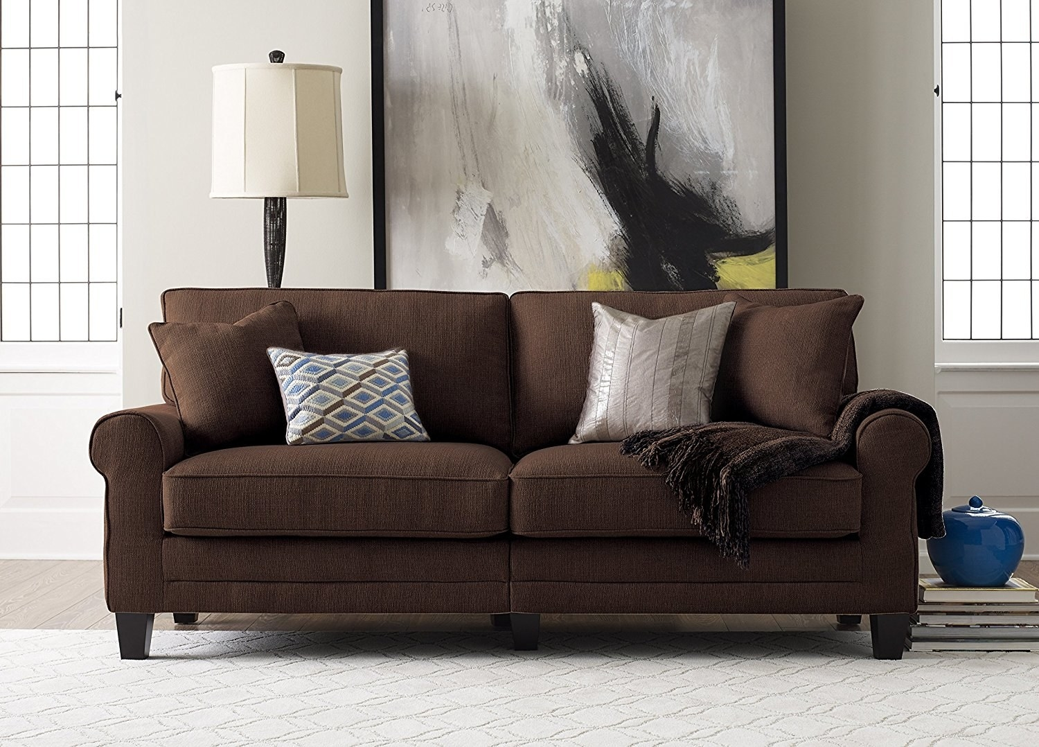 A Brown Sofa Covered In A Velvet Textured Fabric.