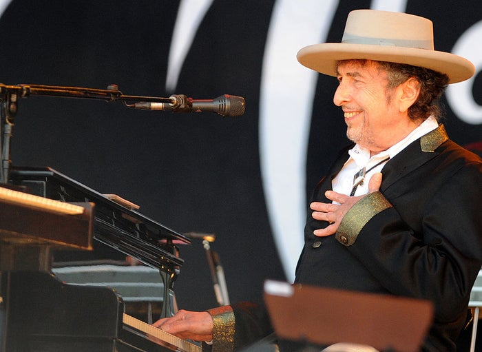 """He was the first songwriter to receive the award — considered the highest honor in literature. Writers and musicians deliberated about whether he should have been eligible, and Dylan himself was characteristically rebellious about the whole thing, declining to attend the Nobel ceremony in Sweden. A member of the Nobel committee concluded that Dylan's behavior was """"impolite and arrogant."""""""