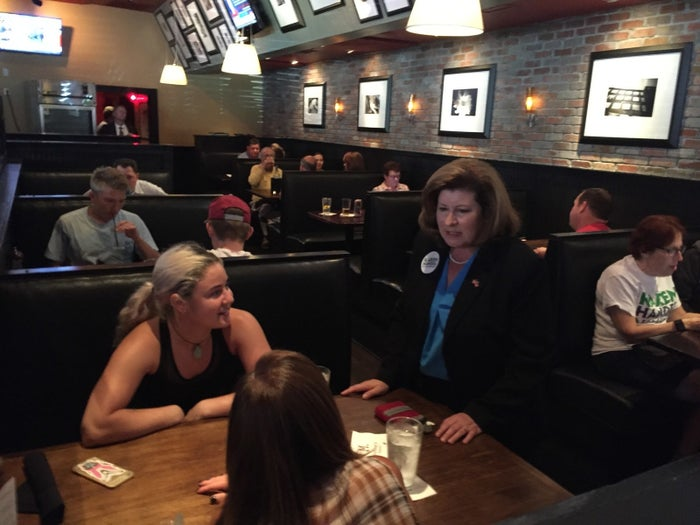 Republican congressional candidate Karen Handel chats with customers Friday during a campaign stop at a tavern in Georgia's 6th District.