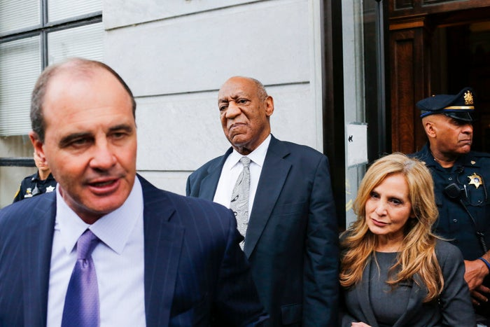 Bill Cosby listens as his defense attorneys Brian McMonagle (left) and Angela Agrusa exit the courthouse after a mistrial on the sixth day of jury deliberations.