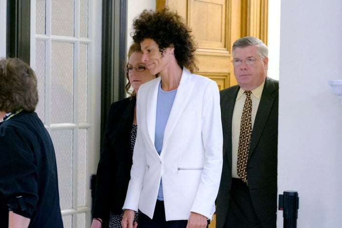 Andrea Constant leaves the courtroom.