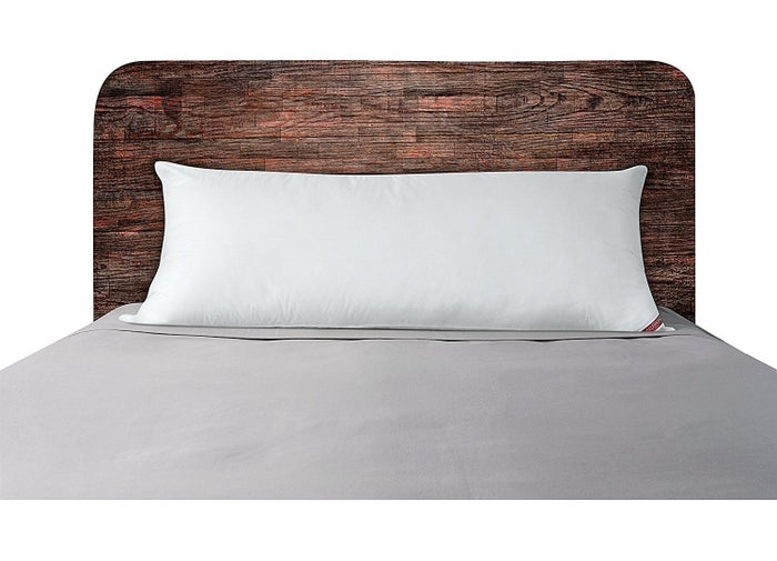 """Promising review: """"I need a body pillow for my back to be able to get any sort of sleep at night. I've had three back surgeries and I just can't sleep on my back or stomach, so I sleep on my side and use the body pillow between my legs. Now I can't sleep without it. The pillow has also held its shape over time. My wife started stealing it, so I had to buy another one for her."""" —The Portly AnglerGet it from Amazon for $14.99."""